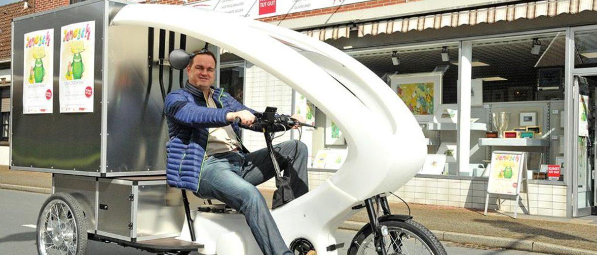 Header Ecargo 1 1210x518 - Kunst tut gut - Kunsthandel Koenen fährt  E-Cargo-Bike